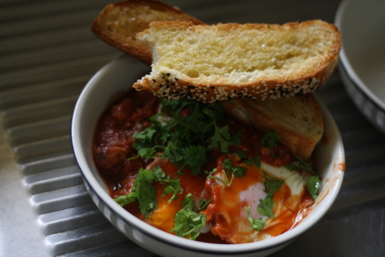 baked eggs topped with fresh coriander & toast